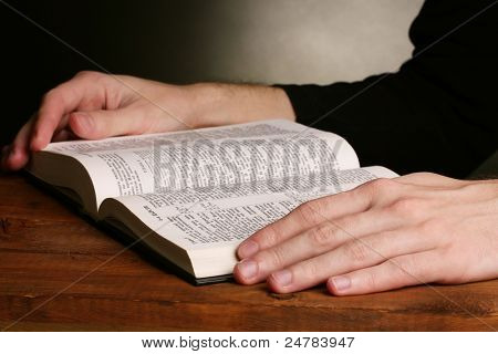 Reading open russian holy bible on wooden table