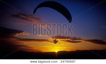 Paraglider At Sunset.