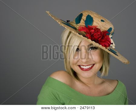 Blonde Smiling In Flowered Hat