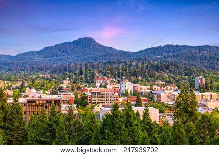 poster of Eugene, Oregon, USA downtown cityscape at dusk.