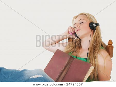 Beautiful Girl Listening To Music And Learn