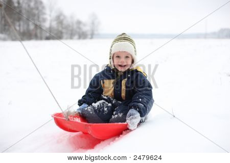 Boy In Sledge