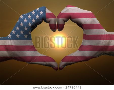 Heart And Love Gesture By Hands Colored In American Flag During Beautiful Sunrise