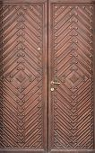 Double Wooden Doors With Diamond And Rivets. Red-brown Color poster