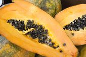 Pile Of Whole And Halved Ripe Juicy Papaya At Asian Farmers Market. Vivid Vibrant Colors Sunlight Le poster