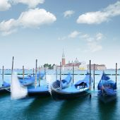 Colorful landscape with clear blue sky on piazza San Marco in Venice. Row of gondolas parked on city poster