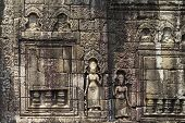 Ancient Stone Bas-relief In Angkor Wat, Cambodia. Ancient Temple Stone Carving. Angkor Wat Bas-relie poster