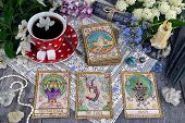 Tarot Cards With Cup Of Tea, Flowers And Black Candles On Planks. Occult, Esoteric And Divination St poster