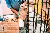 Masonry Details, Bricklayer Building Outside Walls With Ceramic Bricks poster