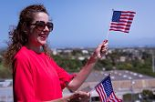 Red Dressed Woman With Usa National Flag Hand Celebrating A Patriotic And American National Holiday  poster