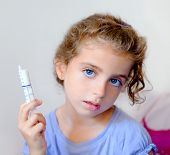 almost happy children kid girl with syringe of antibiotic medicine
