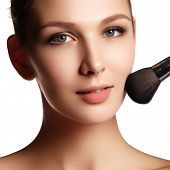 Beauty Model With Makeup Brush. Bright Make-up For Brunette Woma poster