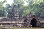 Ancient Temple In Angkor Wat Complex. Ancient Stone Temple Neak Pean In Green Tropical Landscape. Kh poster