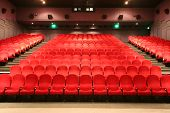Empty Cinema Auditorium With Red Chairs And Lights