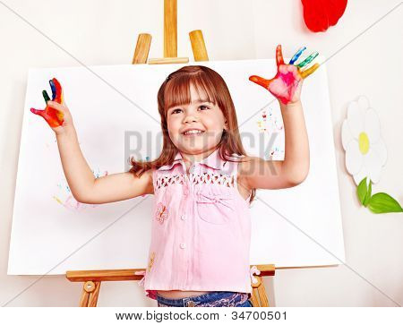 Child paint picture in preschool. Child care.