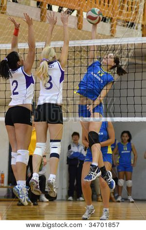 KAPOSVAR, HUNGARY - MAY 18: Agnes Recsei (R) in action at the final of the hungarian junior volleyball championship (Ujpest  white vs. Kaposvar blue) , May 18, 2012 in Kaposvar, Hungary