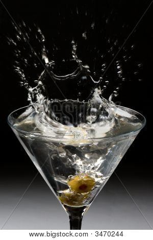Dropping Olives Into A Martini