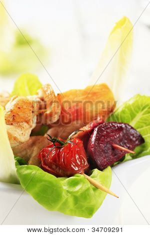 Two fried meat gulps with vegetables on a white tray
