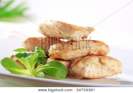 Cut roasted mouthfuls of skinless chicken breast