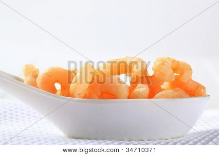 Fruit pap in form of little cornets on a white china ladle