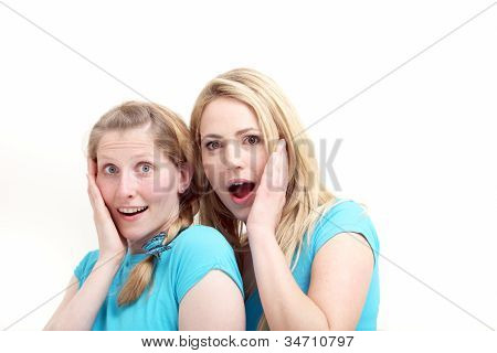 Friends Reacting In Astonishment