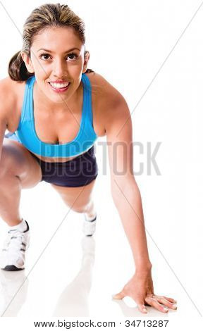 Female athlete ready to run - isolated over a white background
