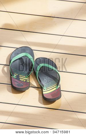 Colorful Sandals On Wood Deck