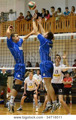 KAPOSVAR, HUNGARY - MAY 18: Unidentified players in action at the final of the hungarian junior volleyball championship (Kaposvar  white vs. Dunaferr  blue), May 18, 2012 in Kaposvar, Hungary