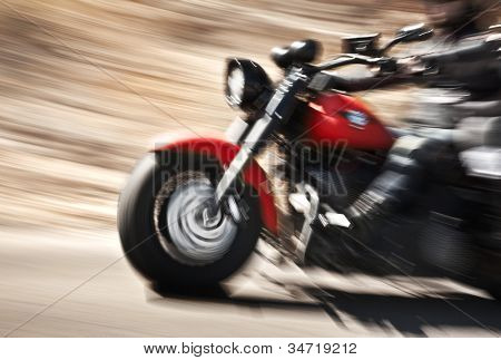 Abstract slow motion biker riding