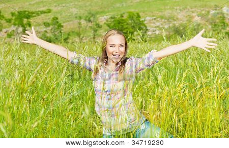 Active female over nature landscape, beautiful girl playing outdoors, young lady raised up open hands, pretty woman laughing, teenager enjoying wheat field, happy person laughing and having fun