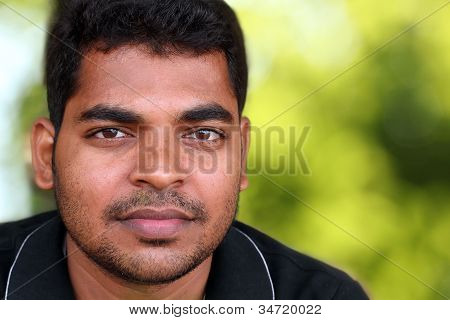 Photo Of Handsome Middle-aged Indian/asian Youth With Content And Satisfied Look. The Eyebrows Are T