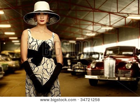 Woman in hat in retro garage