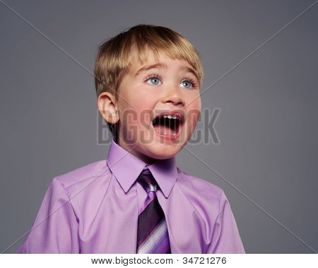 Funny baby boy in purple shirt