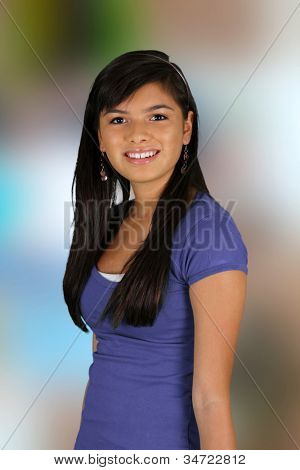 Happy teen girl smiling while standing outside