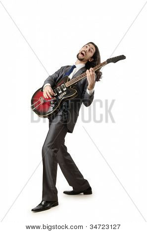 Guitar player in business suit on white