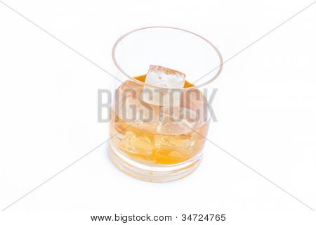 Whiskey on the rocks against a white background
