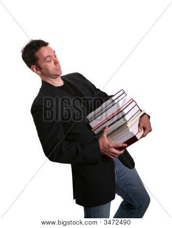 College Student Lugging Books