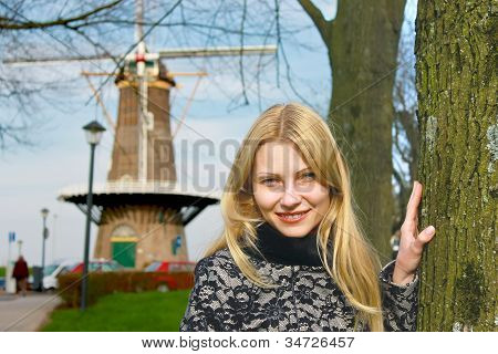 Girl Near  Windmill In  Dutch Town Of Gorinchem. Netherlands