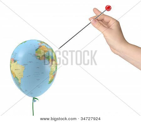The Hand With The Needle Aimed At The Balloon With The Texture Of The Planet Earth