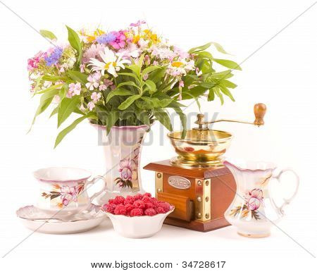 Vintage elegant cups, raspberry and flowers and mills for coffee