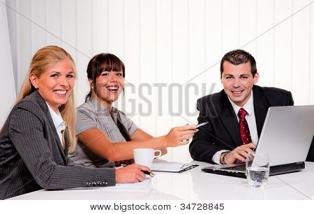 successful young team at a meeting in the office