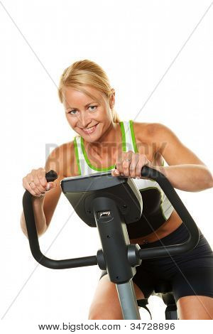 a woman trained in the gym on a bicycle ergometer