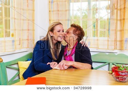a granddaughter to visit his grandmother. hugs and kisses