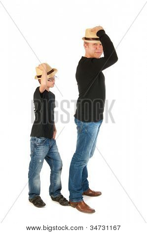 Sturdy father and son standing in the studio