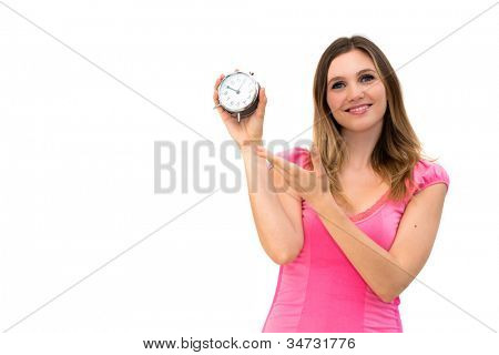 young beautiful woman holding a clock on a white background