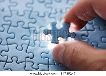 The last piece of jigsaw puzzle concept for solutions and completion