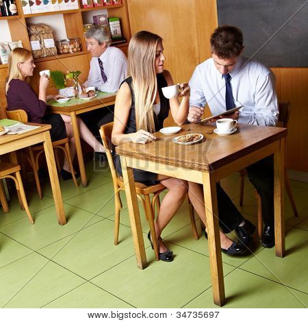 Different business people sitting in a caf�©