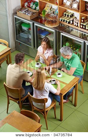 Group of regulars sitting together at table in a restaurant