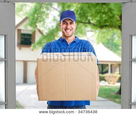 Portrait of an handsome deliverer holding a box