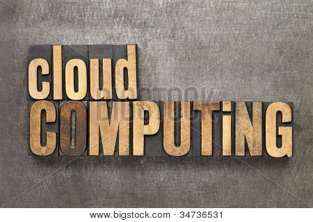 cloud computing - text in vintage letterpress wood type against a grunge metal sheet